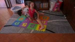 """playing """"twister"""" on the floor mat"""