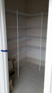 walk in wardrobe with shelving